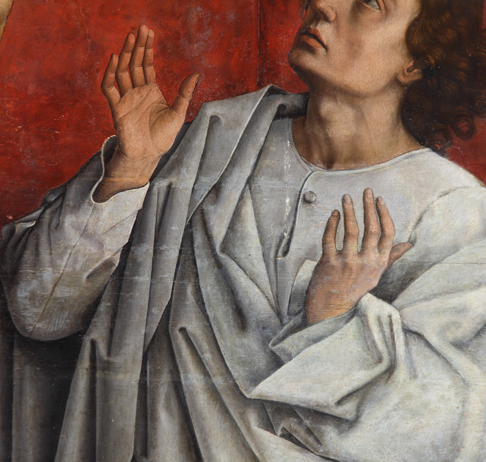 La figura de San Juan cubierta por repintes.
