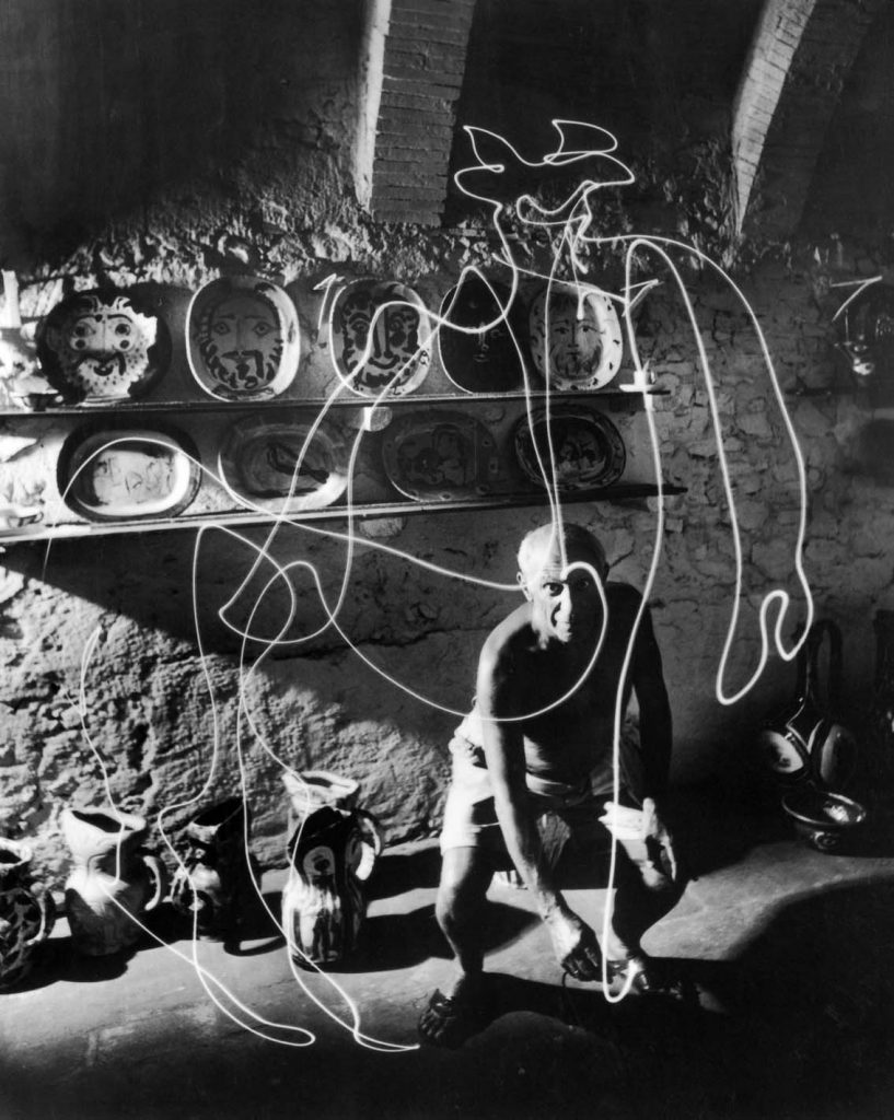 Artist Pablo Picasso drawing a centaur in the air with a flashlight at Madoura Pottery. (Photo by Gjon Mili//Time Life Pictures/Getty Images).