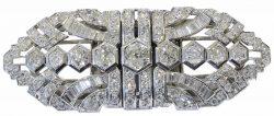 Importante-broche-doble-clip-desmontable-en-platino-y-brillantes.-Años-50.jpg